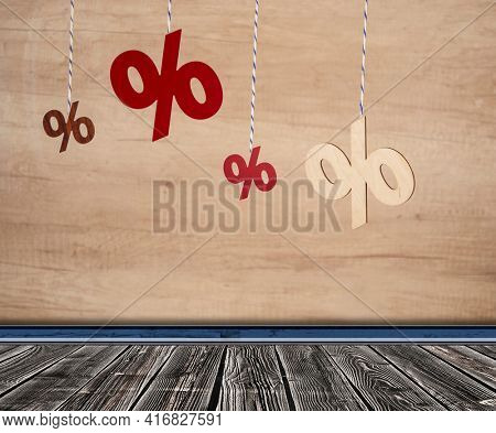 Many sign percents hanging on twine againts wood wall background. Summer winter sale, unsold stock, retail prices, retailers, discount concept