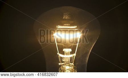 Photo Of Incandescent Bulb On Black Background