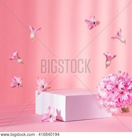 White Square Podium Group For Display Cosmetic And Goods With Fresh Spring Flowers Hovering As Frame