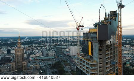 Warsaw, Poland 12.01.2020 - Astonishing Warsaw Cityscape. Skyscrapers With Cranes In The Golden Morn