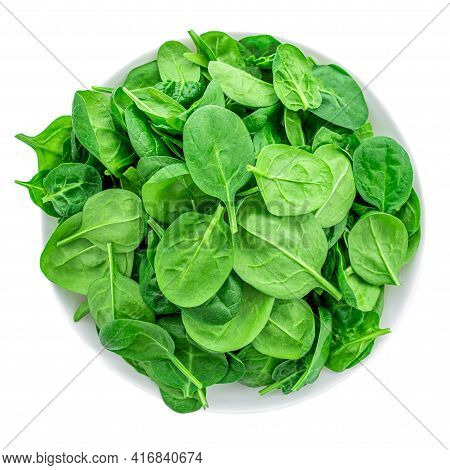 Fresh Spinach Leaves In Bowl Isolated On White Background. Macro. Top View. Flat Lay.