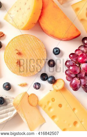 Cheese. Top Flat Lay Shot Of Dmany Different Cheeses, With Grapes