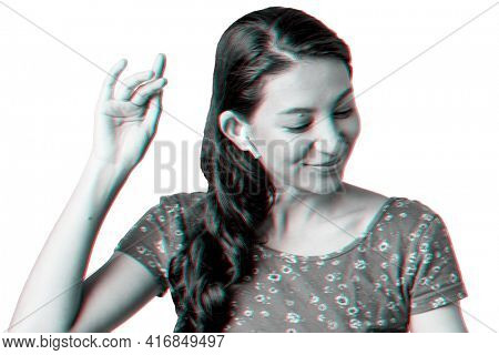 Woman listening to music through wireless earphones in double color exposure effect