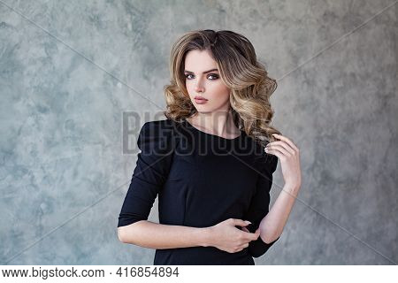 Fashionable Woman With Curly Hairstyle On Gray Background Portrait