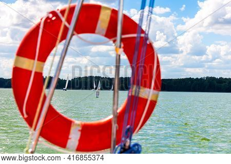 Sailing Concept, View On A Lake Through Lifebuoy. Summer Vacations, Cruise, Recreation, Sport, Regat