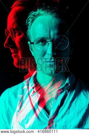 Man with spectacles portrait in double color exposure effect