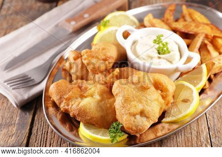 fish and chips- fried breaded fish and french fries