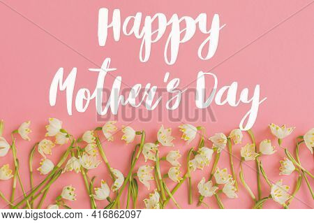 Happy Mother's Day. Happy Mother's Day Text And Spring Flowers Border Flat Lay On Pink Paper. Stylis