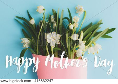 Happy Mother's Day. Happy Mother's Day Text And Flowers Bouquet In Pink Cone On Blue. Stylish Floral
