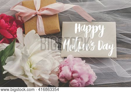 Happy Mother's Day. Happy Mother's Day Text On Card And Beautiful Peony Bouquet, Gift Box On Soft Tu