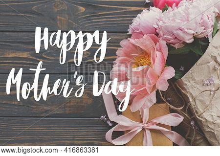 Happy Mother's Day. Happy Mother's Day Text And Peony Bouquet In Paper, Gift Box On Rustic Dark Wood