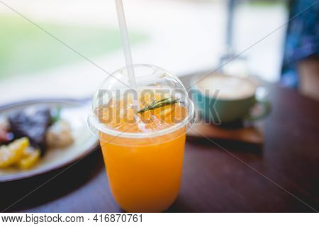 Picture Of A Freshly Squeezed Orange Juice With Drinking Straw In Breakfast Time