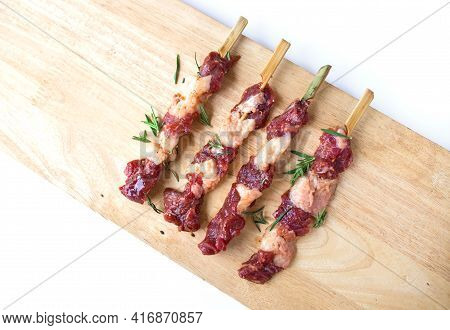 Fresh Raw Beef Meat With Rosemary Isolated On White Background. Food Meat Preparation Cooking Concep
