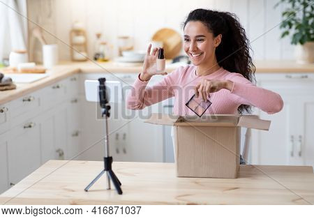 Beauty Blogging. Happy Attractive Lady Unboxing Parcel With New Cosmetics At Camera