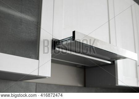 Grey Stainless Cooking Glass Hood On Modern White Minimalist Style Kitchen. Kitchen Supplies.