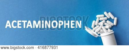 The Word Acetaminophen Is Written Near Pills On A Light Blue Background. Medical, Health And Happine