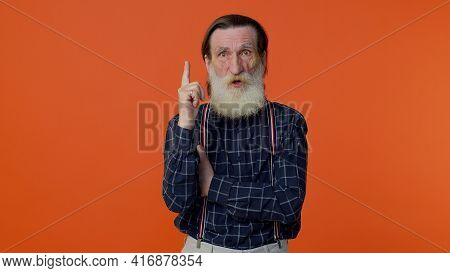 Inspired Mature Old Bearded Gray-haired Grandfather In Casual Blue Shirt Pointing Finger Up With Ope