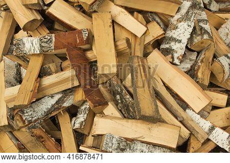 Freshly Cut Birch Firewood. Firewood Background. Pile Of Firewood
