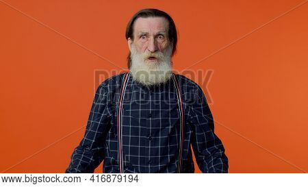 Stressed Depressed Mature Old Bearded Gray-haired Grandfather Expresses His Fear And Waves His Hands