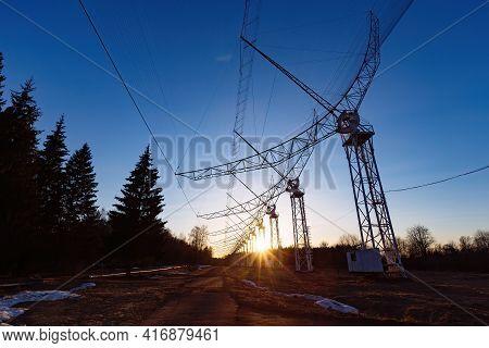 Antenna Array. A Long Row Of Radio Telescopic Antennas At The Sunset