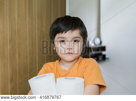 Asian Kid Suffering From Stomachache Problem By Eating Contaminated Food,sad Child Has Stomach Pain