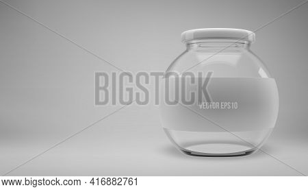 Glass Jam Jar With A Lid. A Transparent Jar With A White Lid And Label.
