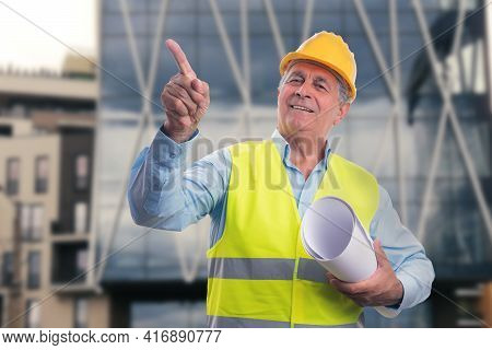 Friendly Old Male Contractor Builder Architect Wearing Fluorescent Vest And Yellow Hardhat Holding S