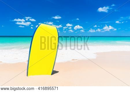 Surfboard On Beach Background. Travel Adventure Sport And Summer Vacation Concept.