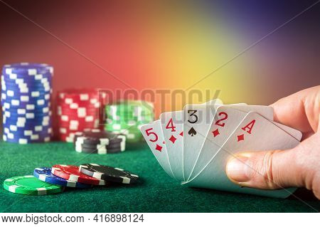 Poker Cards With High Card Combination. Close Up Of Gambler Hand Takes Playing Cards In Poker Club