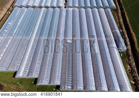 Greenhouses Aerial View. Greenhouse Farming, Vegetable Cultivation In Greenhouses, Agriculture Indus