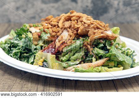 Bbq Chicken Salad Piled High With Romaine, Chicken Breast, Lettuce, And Dressing To Fill Any Appetit
