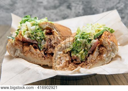 Bbq Chicken Sandwich Loaded With Sauce, Bacon, Avocado, And Tomato Completely Filling Bread Roll.