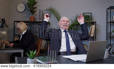 Senior Old Business Man Accountant Reading Documents, Analyzing Financial Papers, Preparing Audit Re