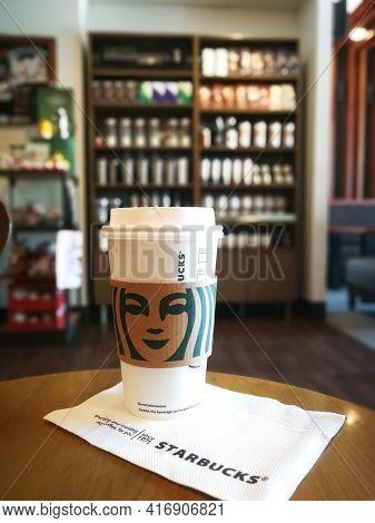 Starbucks Coffeehouse, Kota Kinabalu, Malaysia - April 13, 2021 : White Disposable Starbucks Coffee