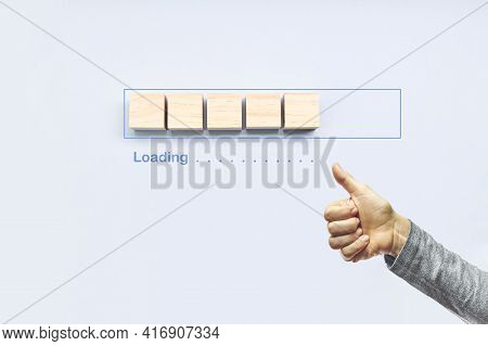 Loading, Ok Gesture Next To The Progress Bar Filling With Wooden Cubes. Unloading Progress. Loading