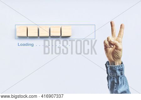 Loading, Victory Gesture Next To The Progress Bar Filling With Wooden Cubes. Unloading Progress. Loa