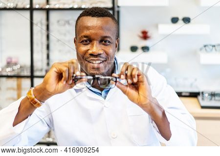 Ophthalmologist Doctor African American Man Showing Eyeglasses With New Lenses For Vision Into The C