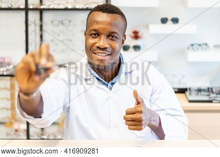 Ophthalmologist Doctor African American Man Showing Eyeglasses With Thumbs Up For Vision Into The Ca