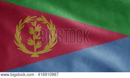 Eritrean Flag Waving In The Wind. Close Up Of Eritrea Banner Blowing Soft Silk.