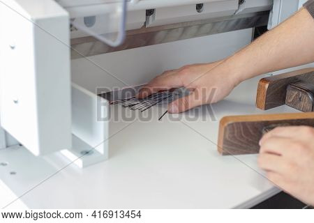 A Specialist Operator Removes The Scraps And Edges Of A Stack Of Business Cards Or Tags On An Automa