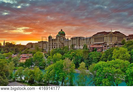 Panoramic Of Dramatic Red Sunset Sky And Federal Palace In Bern, Switzerland. Swiss Parliament Build