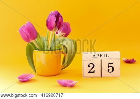 Calendar For April 25: Cubes With The Number 25 , The Name Of The Month Of April In English, A Bouqu