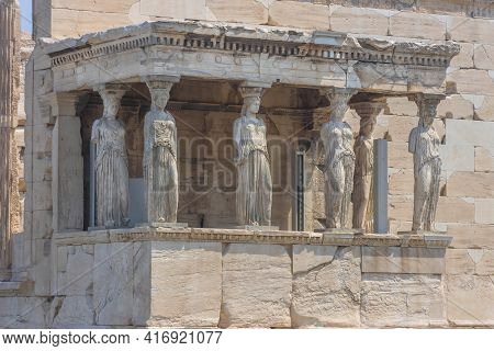 Architecture Detail Of The Caryatids Of The Ancient Erechtheion Temple On Acropolis Hill, Famous Tou
