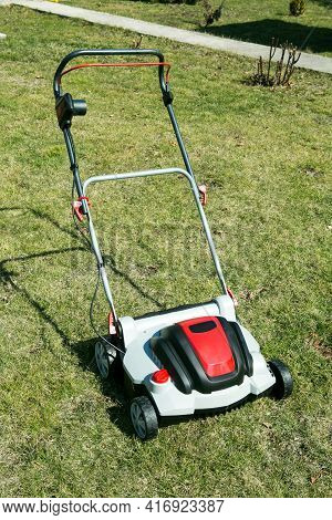 Aerator Standing In Grass. Aeration With A Scarifier. Using A Scarifier In The Garden To Improving Q