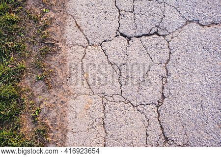 Asphalt Texture With Cracks On Rural Road