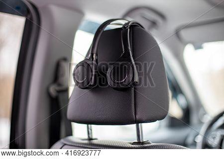 Moscow, Russia - February 2, 2020: The Original Headphone System Multimkdia Rear Passenger Headrest