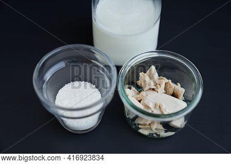 Milk, Sugar And Fresh Wild Yeast As Bread Baking Ingredients Concept. Yeast Starter Ingredients In T