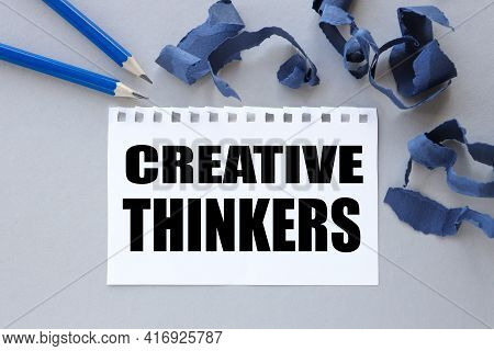 Creative Thinkers. Text On White Notepad Paper. Near Torn Blue Paper