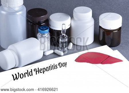 Medicine Bottles, Vaccine, White Paper With Lettering World Hepatitis Day. Cancer Of The Liver, Hepa