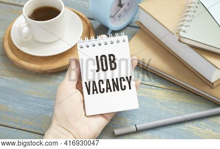 Job Vacancy Text Written On A Notebook With Hand